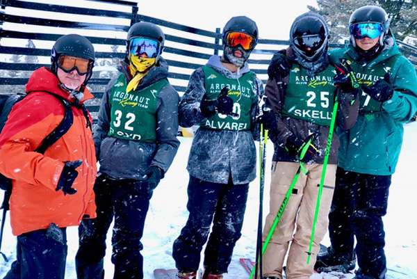 Ski Team line up for photo at an event